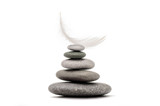 Stone balance with plume. Spa stones isolated on white background.  - 191219681