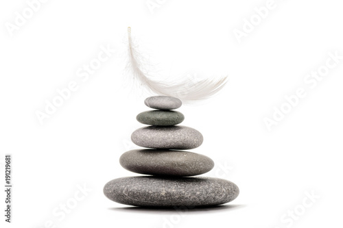 Papiers peints Spa Stone balance with plume. Spa stones isolated on white background.