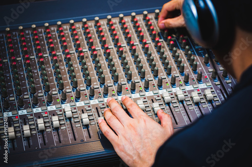Fotobehang Muziek male sound engineer hands working on audio mixing console. music background
