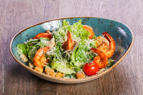 Fototapeta Caesar salad with shrimps
