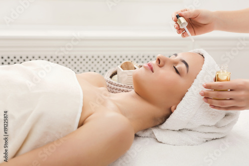 Woman getting professional facial massage at spa salon