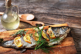 fish on rustic table with fresh ingredients for cooking - 191231460