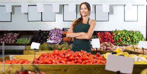 Adult female seller wearing apron