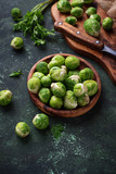Brussels sprouts on green concrete background - 191237450