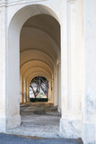 Gallery of arches, ancient church portico with sunset light - 191239499