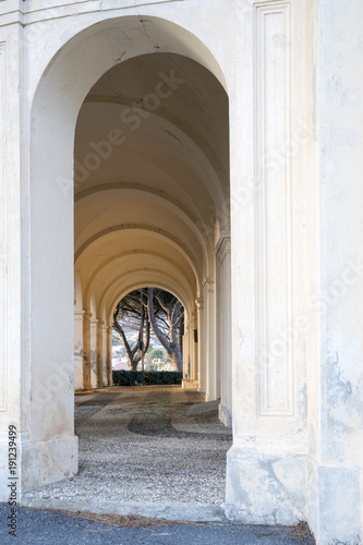 Gallery of arches, ancient church portico with sunset light