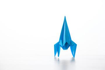 Paper homemade origami rocket. © bravissimos
