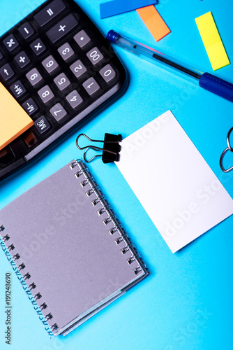 Bookmarks of different colors near grey notebook and pen - 191248690