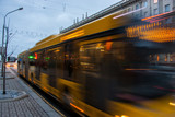 The motion of a blurred bus on the avenue at dusk. - 191249004