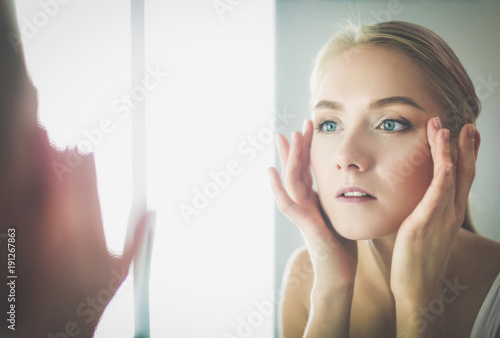 Fotobehang Spa face of young beautiful healthy woman and reflection in the mirror