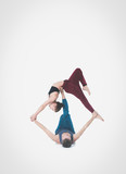 Young athletic couple practicing acroyoga. Balancing in pair - 191269420