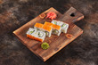 Japanese food sushi maki rolls on wooden board