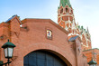 fragment of moscow kremlin wall with Trinity tower and metal gates