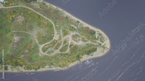 Foto op Plexiglas Khaki Top view of the Cape on the lake. Clip. Stunning lake and foreland view from mount