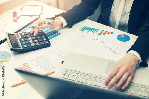 woman working with business reports in office