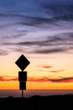 Road sign silhouette and colorful sunset - 191311838