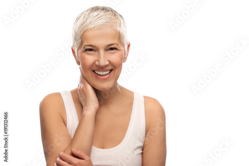 Leinwandbild Motiv Portrait of a beautiful elderly woman, smiling, isolated on white background