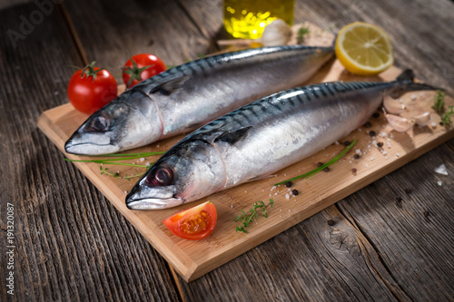 Fresh mackerel on wooden background