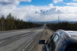 Long stretch of flat highway in Saskatchewan prairies, Canada