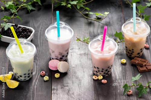 Milky bubble tea with tapioca pearls in plastic cup
