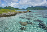 The lagoon with a rocky islet of the island of Huahine near Maroe bay, Pacific ocean, French Polynesia - 191324429