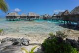 Tropical island resort with bungalows on stilt in the lagoon, Tikehau atoll, Tuamotus, French Polynesia, Pacific ocean, Oceania - 191324649