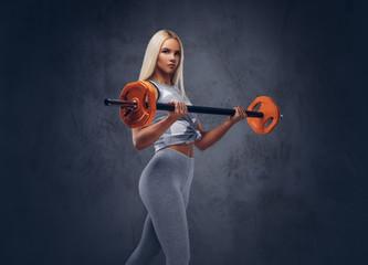 Studio portrait of a sporty woman. © Fxquadro