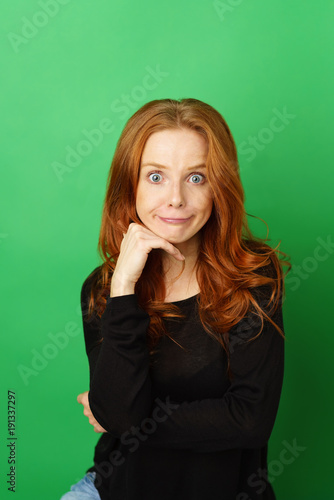 Cute pretty redhead woman pulling a goofy face