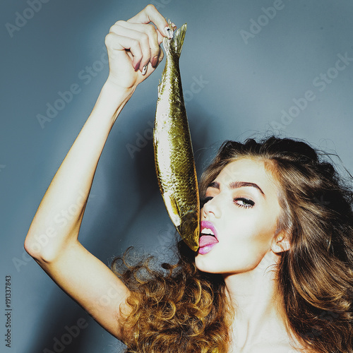 Sexy girl or woman lick golden herring
