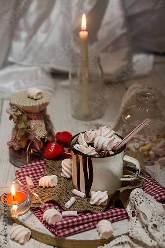 Foto op Canvas Chocolade Mug of hot chocolate drink with marshmallow candies on top and candles on white background. Valentin's day love concept.