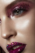 Beautiful girl with creative bright makeup with rhinestones Beauty face. Photos shot in studio