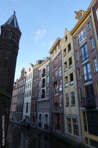 Deurstickers Amsterdam Narrow canal between typical houses in Amsterdam