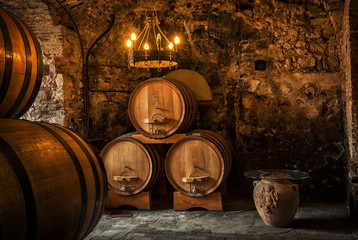 Old Wooden barrels with wine in a wine vault