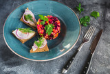 Traditional Russian beetroot salad vinaigrette with fish on bread - 191351816
