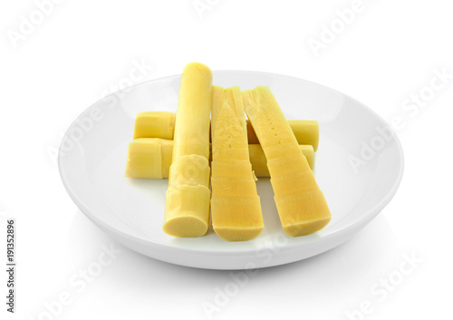 Fotobehang Bamboe bamboo shoots in a plate on white background