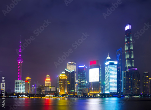 Foto op Canvas Shanghai Modern city skyscrapers of Shanghai skyline at night with reflection of beautiful ligth in Huangpu river view from the bund, Shanghai, China