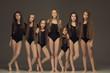 The group of teen girls posing at white studio