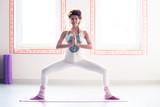 young woman practice yoga indoor full body shot - 191360883