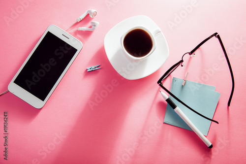 Coffe break of an office employee. Working with a cup of coffee and snacks, using a phone - 191362411