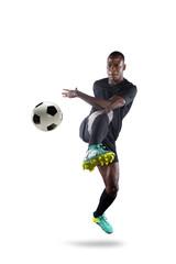 African American Soccer Player Kicking Ball