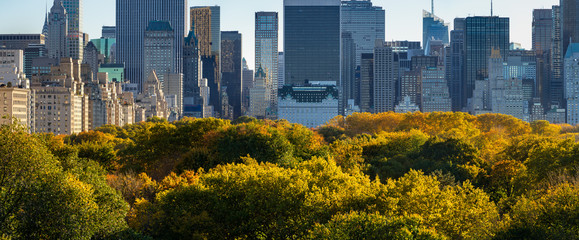 Panoramic view of Midtown skyscrapers and Central Park tree tops in Fall. Central Park South, Manhattan, New York City