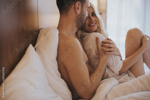 Loving couple on the bed