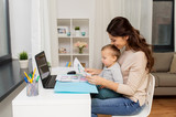 mother with baby and documents working at home - 191369840