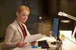 businesswoman with papers working at night office - 191370276