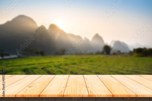 Aluminium Guilin Wood table top with blurred mountain in morning background.