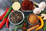 Spices and herbs on grey background. Food and cuisine ingredients. - 191382863