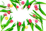 Spring gift. Flowers and sweets. Tulips and sweets macarons on white background top view copy space - 191383003