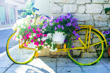 charming street decoration - old bike with flowers