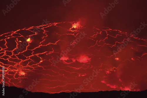 Foto op Canvas Rood paars Mouth of the volcano with magma. Molten magma in the muzzle