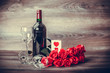 Wine and red roses